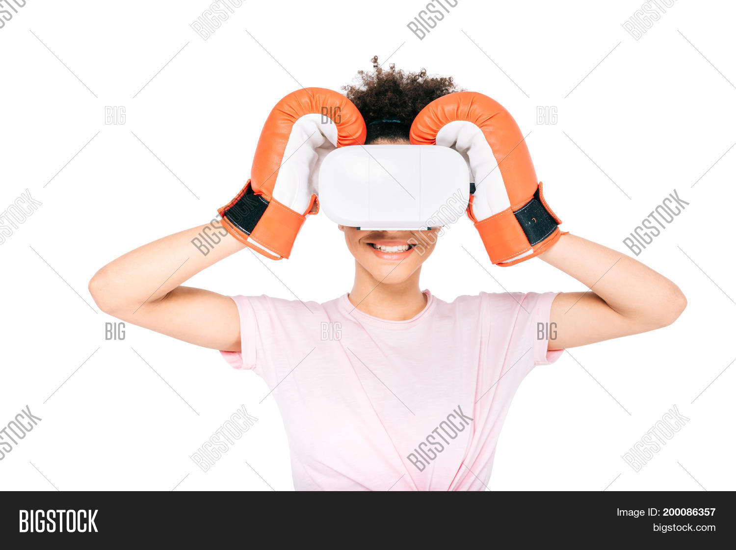 cef3581c2058 smiling african american girl in boxing gloves adjusting virtual reality  headset isolated on white