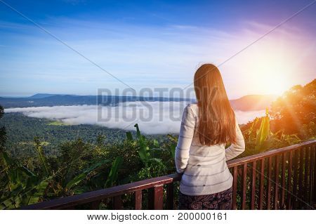 Woman traveler looking sea of mist at Khao Kho Thailand.
