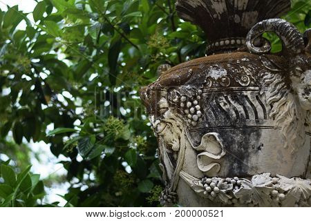 Stone vase with satyr and goat closeup, park decorations, Portugal