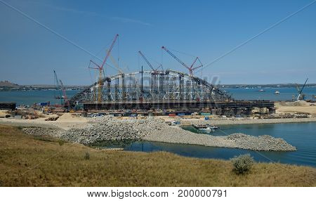KERCH RUSSIA JULY 15 2017: construction of a bridge with road and rail passages across the Kerch Strait which will connect the Taman Peninsula and the Crimea.