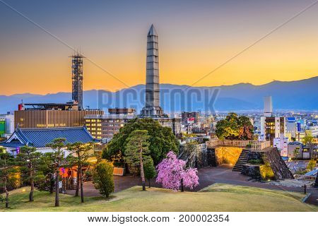 Kofu, Yamanashi, Japan downtown cityscape and monument tower.