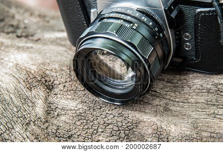a camera on wooden background vintage style