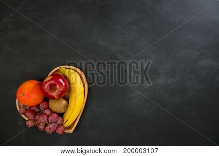 Tropical Fruit In Wooden Heart Shaped Plate