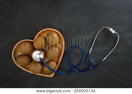 Hospital Stethoscope Touching Fresh Kiwi Fruit