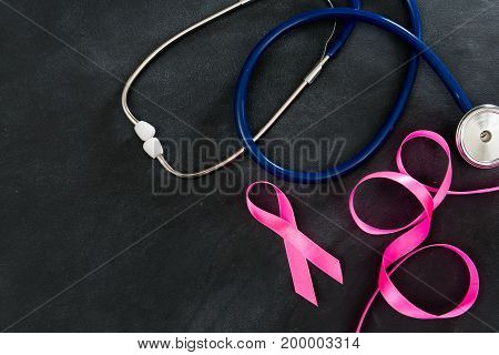 Stethoscope With Ribbon On Blackboard Background