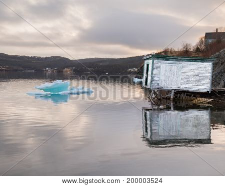 Rustic Shack And Ice On Water