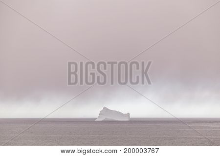 Iceberg And Rain Clouds