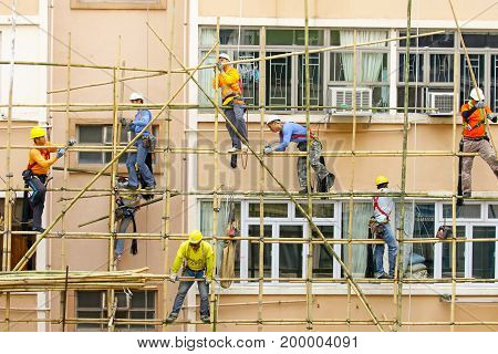 March 6, 2017. Hong Kong. Workers working on a bamboo scaffold in Hong Kong, China