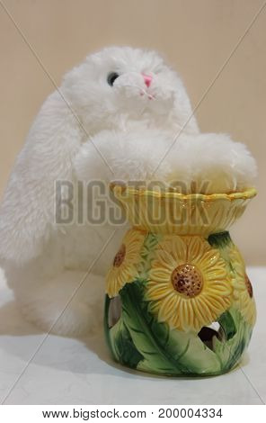 Soft toy white rabbit and an aroma lamp