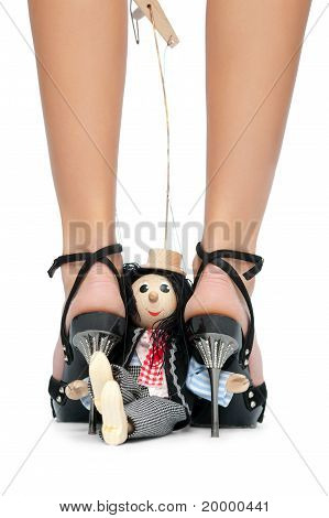Toy Puppet Sits Near The Feet Of A Woman