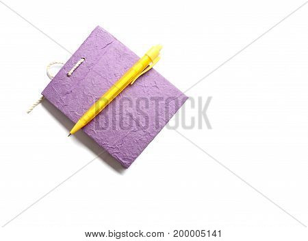 Purple Notebook Paper With Pencil Ion White Background