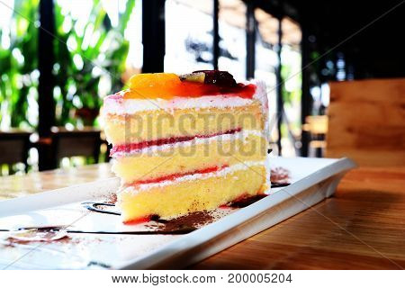 A Piece Of Mixed Fruit Cake At Coffee Shop On Wooden Table