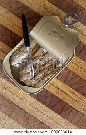 Tin of sardines in mineral water with a fork.
