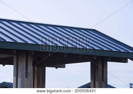 Close up of a blue aluminum roof in a park