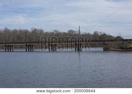 Short highway overpass bridge over beautiful scenic waterway