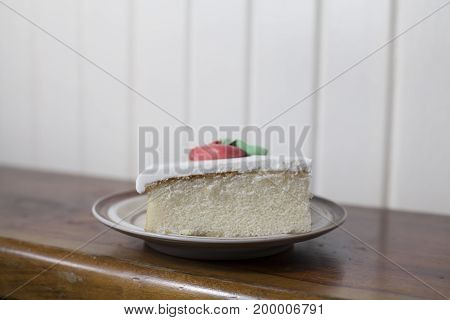 Single slice of white cake with buttercream icing