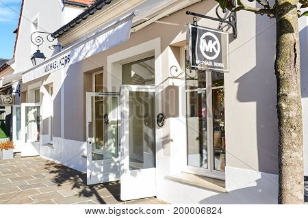 PARIS FRANCE - MAY 10 2017 : Michael Kors boutique in La Vallee Village. The Michael Kors brand is known for designing a wide range of fashion accessories including watches.