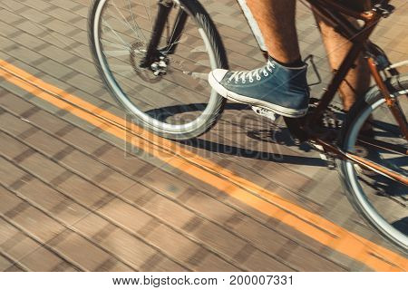 Unrecognizable Cyclist Rides A Bicycle Path Motion Blur. Point Of View Shot