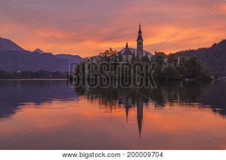 sunrise over a mountain in the Lake Bled in the Julian Alps in Slovenia