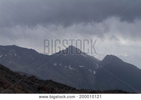 Rocky tops and clouds above them view from the of Elbrus North Caucasus Russia