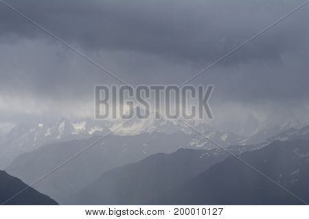 Snow-capped mountain tops hidden by clouds view from the of Mount Elbrus North Caucasus Russia