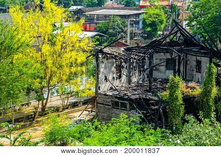 urban house fire Structure after burning near the canal