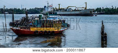 Cargo Ship and small tug boat view of chao phraya river in bangkok thailand