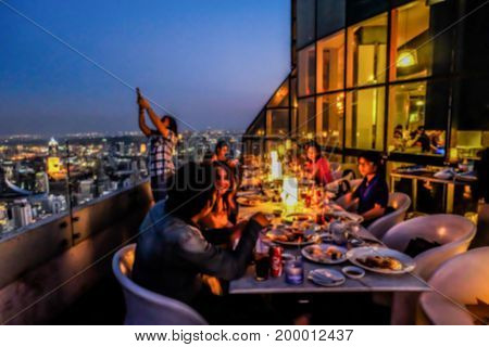 blur concept view from high building megapolis Bangkok city view from above Thailand on sunset with dinner thailand