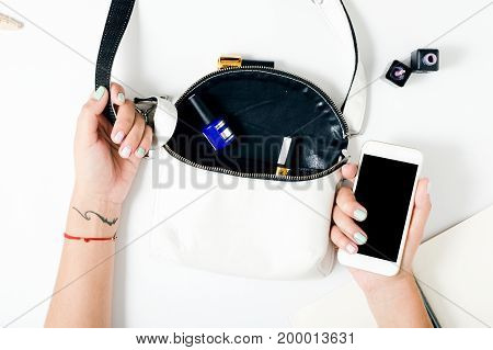 Hands of woman with beautiful summer manicure on white background top view flat lay