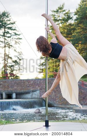 Young sexy pole dance woman on air