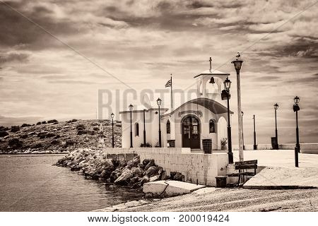 Vintage style photo of Greek Small Chapel on sepia tone. Artistic image