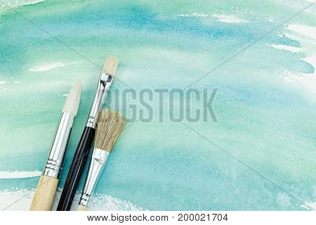 Hand Painted Watercolor Paper In Green Colors With Paintbrushes