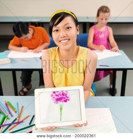 Vietnamese schoolgirl showing bouquet she drew of tablet computer