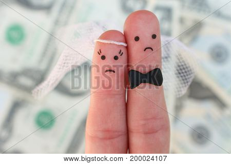 Fingers art of couple on background of money. Concept of wedding, woman and man needs to get married, but they don't want. Arranged marriage.