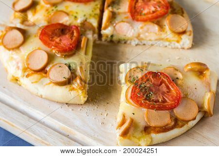 Closeup of Hot Homemade Sausages Pizza on table