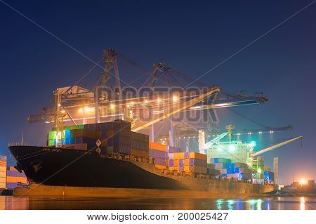 Cargo shipping and terminal loading at night scene.