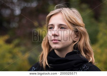 Nice Girl Outdoor In An Autumn Day