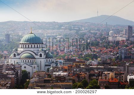 Aerial view of old Belgrade, capital of Serbia with St. Sava temple and Avala tower in the background