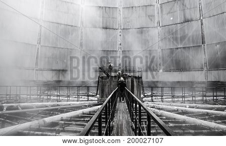 People observing water cooling tower spray heads