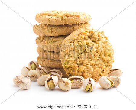 Sweet pistachio cookies and pistachio nuts isolated on white background.