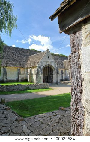 Exterior view of the historic Tithe Barn, a medieval monastic stone barn, Bradford on Avon, UK