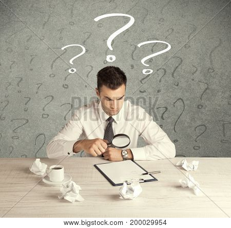A confused busy elegant office worker in trouble with illustrated question marks concept
