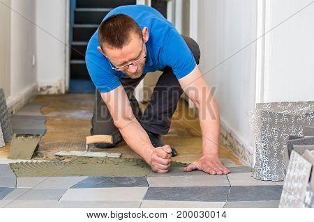 Tiler Installing Ceramic Floor Tiles