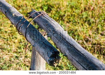 Wooden Fence Details Wrapped By A Wire