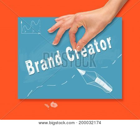 A Hand Picking Up A Brand Creator Concept On A Portable Computer.