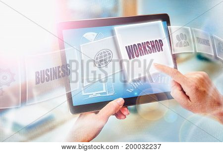 A Businesswoman Selecting A Workshop Business Concept On A Futuristic Portable Computer Screen.
