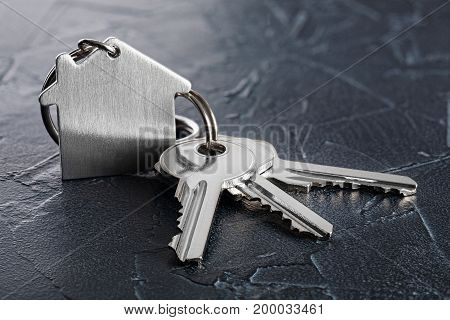 Estate Concept With Key, Keychain With House Symbol, Stone Background