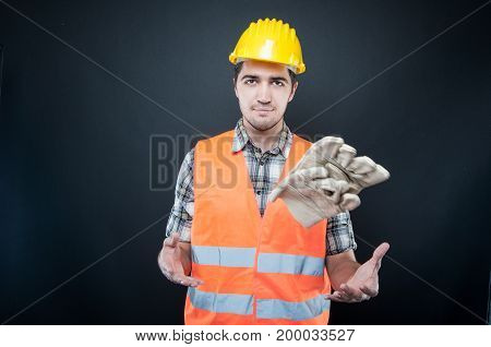 Handsome Constructor Playing With His Gloves