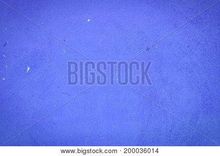 Background Of A Blue Stucco Coated And Painted Exterior, Rough Cast Of Cement And Concrete Wall Text