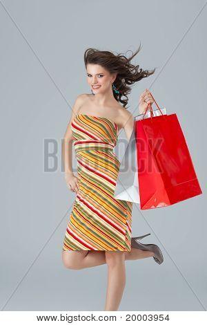 Brunette Woman Carrying Shopping Bags